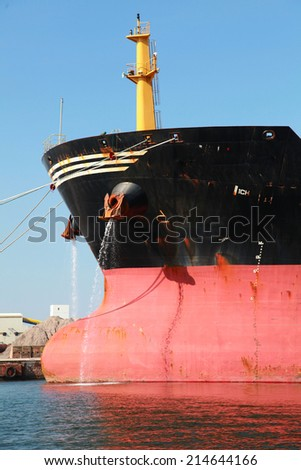 Bow of big red industrial cargo ship - stock photo