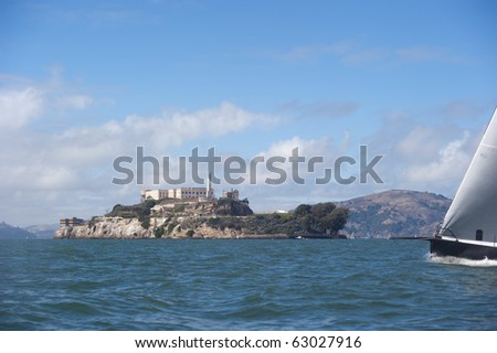 bow of boat passing the island of alcatraz in san francisco bay