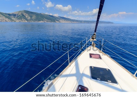 Bow of sailing boat / yacht with blue sea - stock photo