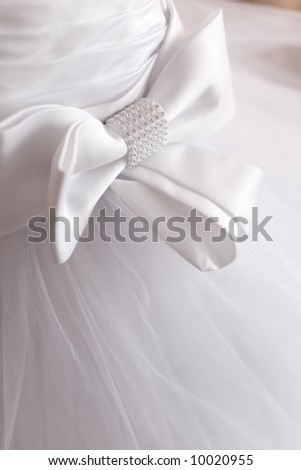 Bow on corset of wedding gown - stock photo