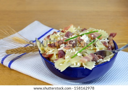 stock-photo-bow-tie-pasta-with-bacon-and