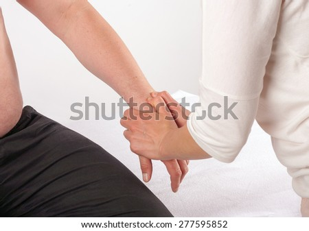 Bowen therapy - treatment of a man's hand