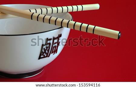 Bowl and Chopsticks - stock photo
