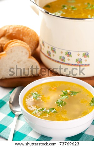 Bowl and pot of chicken soup - stock photo