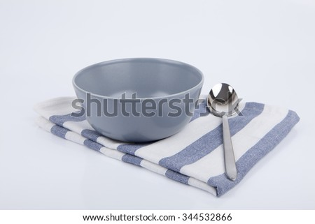 Bowl and spoon isolated - stock photo