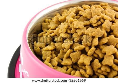 Bowl full of dog food - stock photo