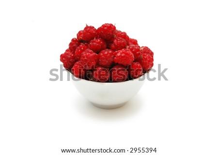 Bowl full of  raspberries isolated on white - stock photo