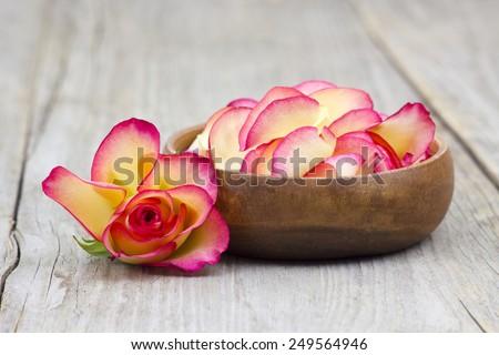 bowl full of rose petals - stock photo