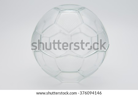 Bowl glass shaped soccer ball, white background.