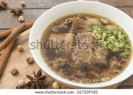 Bowl of beef soup (Food Thailand called Kaolao Nuea pueai). - stock photo