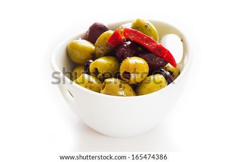 Bowl of black and green olives with chilli - stock photo