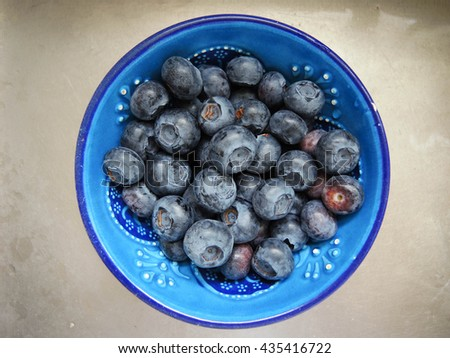 Bowl of blueberries - stock photo