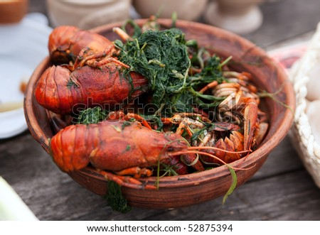 Bowl of boiled crawfish with green onion - stock photo