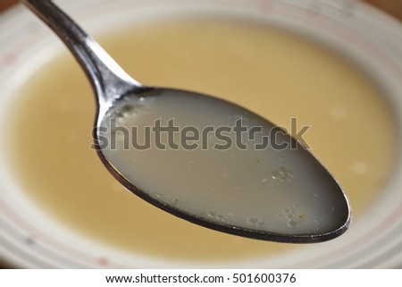 bowl of bone broth with spoon of broth
