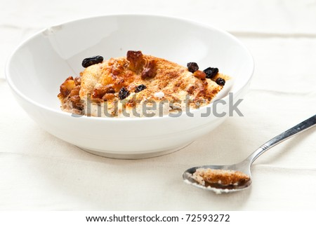 Bowl of bread and butter pudding - stock photo