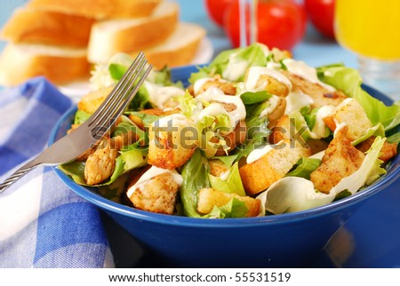 bowl of caesar salad with lettuce,grilled chicken and croutons - stock photo