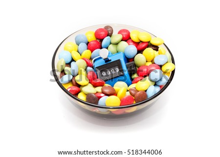 Bowl of candies with Hand tally - concept of excess sugar