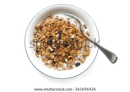 Bowl of cereal with spoon, isolated on white.  Overhead view. - stock photo