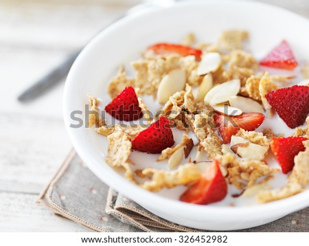 bowl of cereal with strawberries and almonds - stock photo