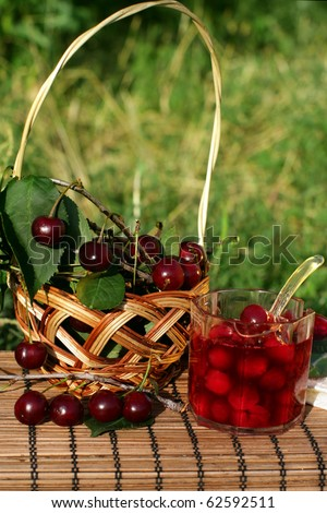 Bowl of cherry jam and some fresh fruits - stock photo