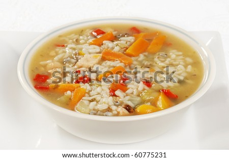 bowl of chicken and wild rice soup with vegetables - stock photo