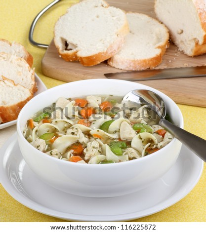 Bowl of chicken soup with noodles and vegetables