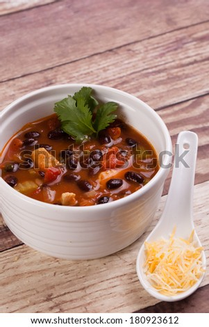 Bowl of Chicken Tortilla soup with Cornbread - stock photo