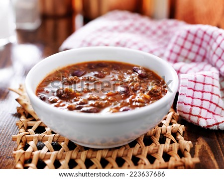 bowl of chili cooling on table - stock photo