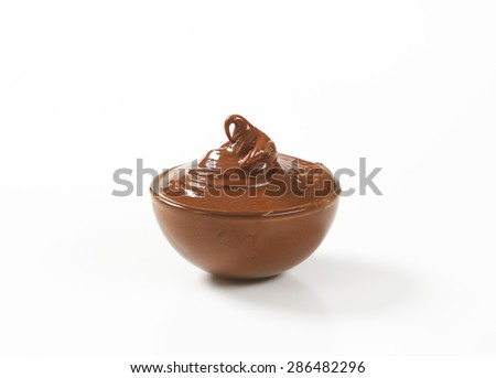 bowl of chocolate spread on white background - stock photo