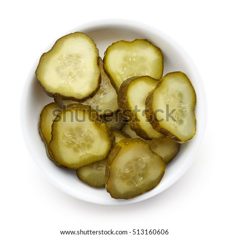 Bowl of chopped pickled cucumber isolated on white, top view