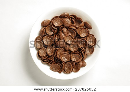 Bowl of cocoa crunch cornflakes isolated on the white background - stock photo