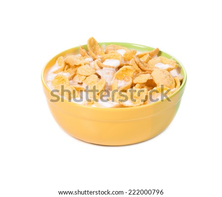 Bowl of corn flakes isolated on white. Isolated on a white background.  - stock photo