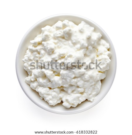 Bowl Of Cottage Cheese Isolated On White Background Top View