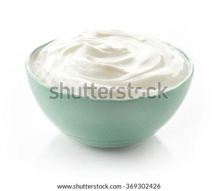 Bowl of cream on white background - stock photo
