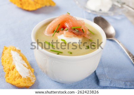 Bowl of creamy leek soup with smoked salmon and cream cheese