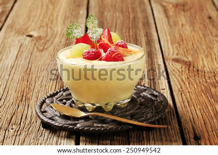 Bowl of creamy pudding with fresh fruit - stock photo