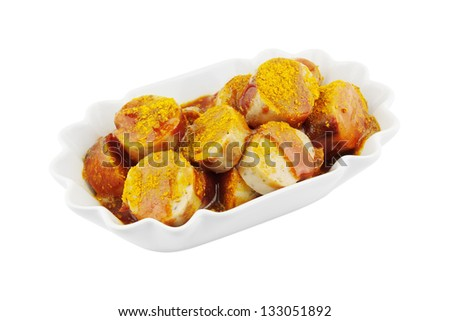 Bowl of currywurst isolated on white - stock photo