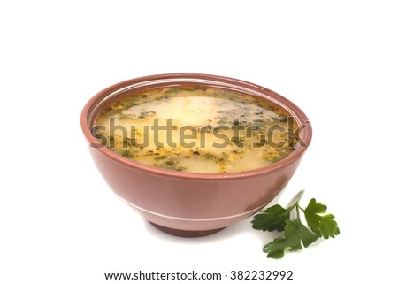 bowl of delicious green soup - stock photo