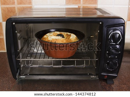 Bowl of food in a microwave oven - stock photo