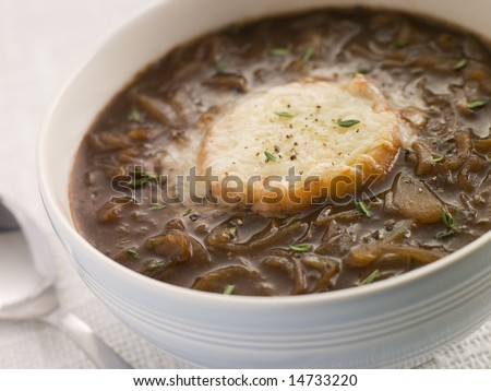 Bowl of French Onion Soup with a Goats Cheese Crouton - stock photo