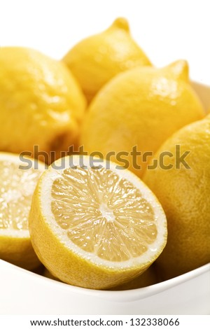Bowl of fresh and juicy lemons - shallow DOF