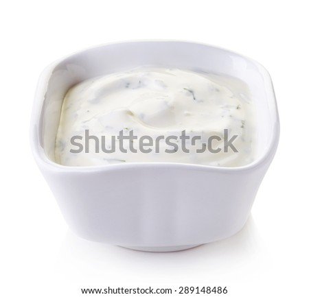 Bowl of fresh garlic dip sauce isolated on white background - stock photo