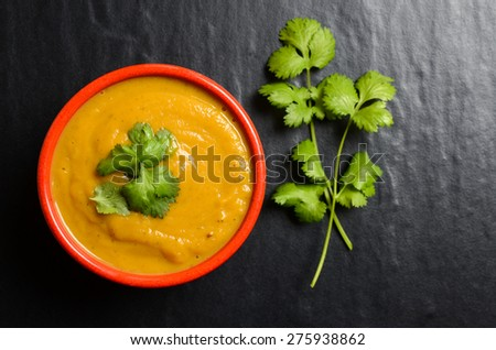 Bowl of fresh homemade sweet potato soup with coriander dressing - stock photo