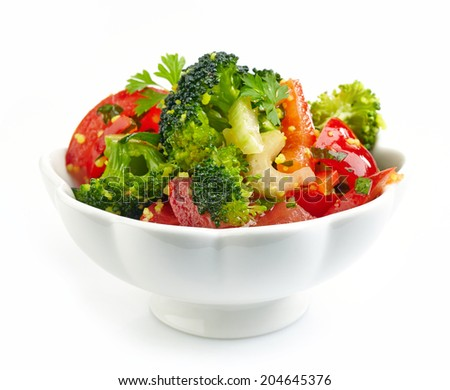 bowl of fresh vegetable salad isolated on white - stock photo