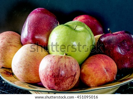 Bowl of fruit with apples and peaces - stock photo