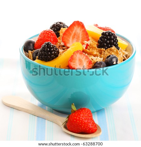 Bowl of granola with fresh berry isolated on white background - stock photo