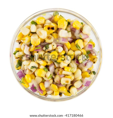 Bowl of grilled corn and onion mix isolated on white and viewed from above. - stock photo