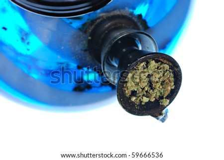 Bowl of ground cannabis leaves in a water bong - stock photo