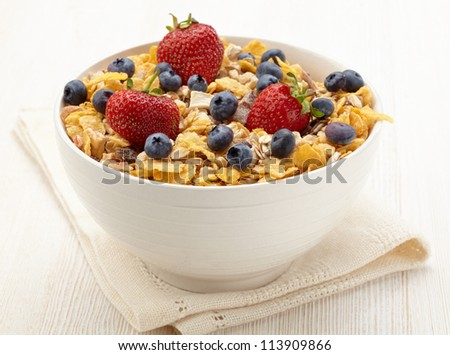 Bowl of healthy muesli and fresh berries - stock photo