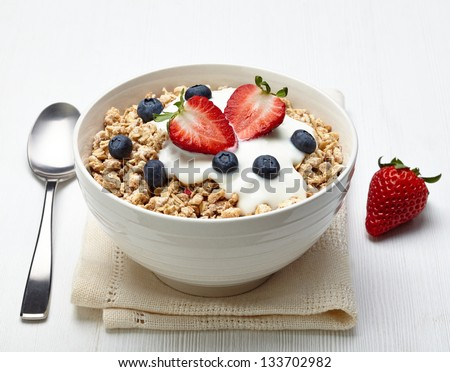 Bowl of healthy muesli with yogurt and fresh berries - stock photo